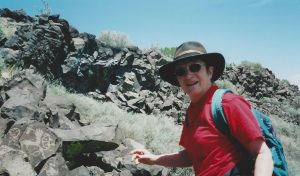 Nancy Wood exploring petroglyphs in NM, 1990s